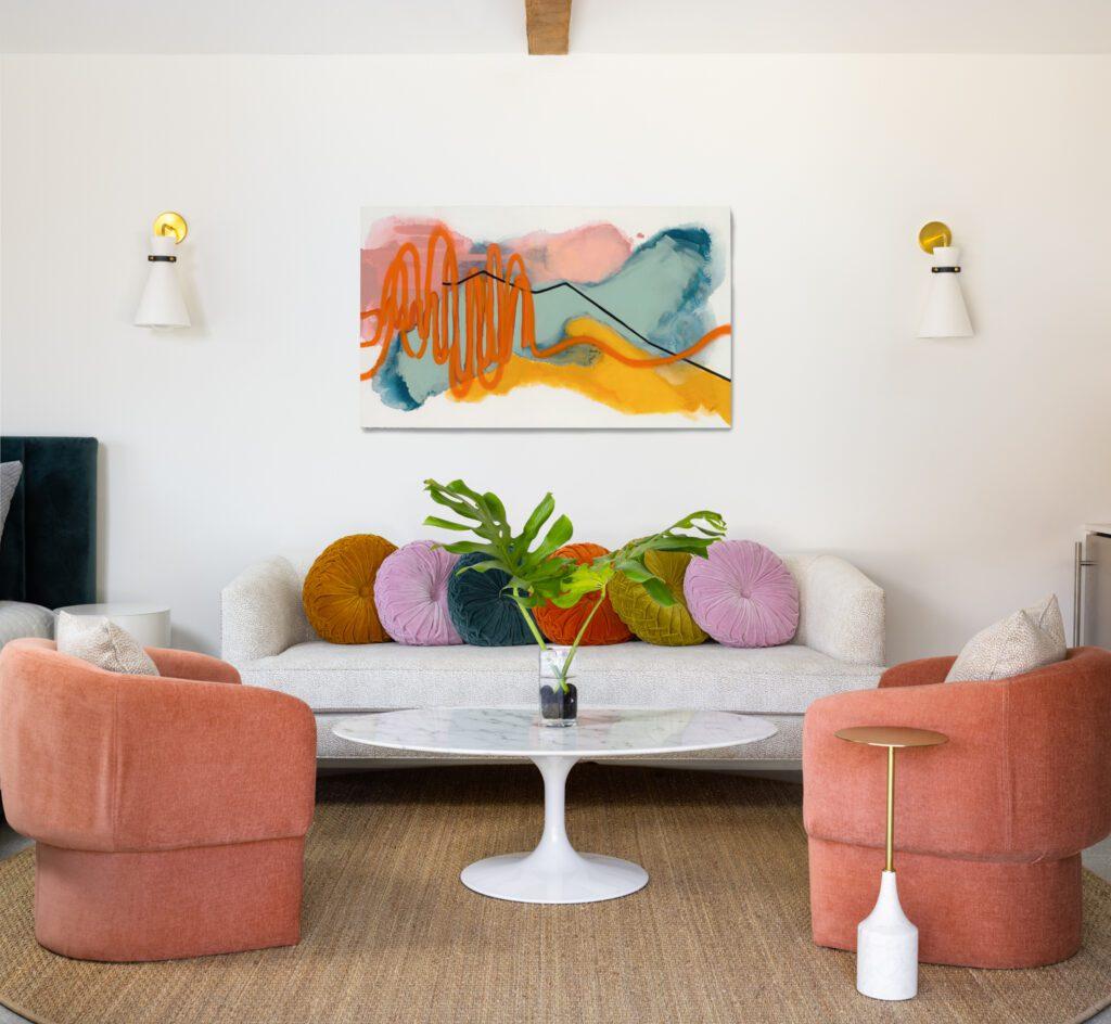 The furnishings and artwork offer pops of color in the living room.