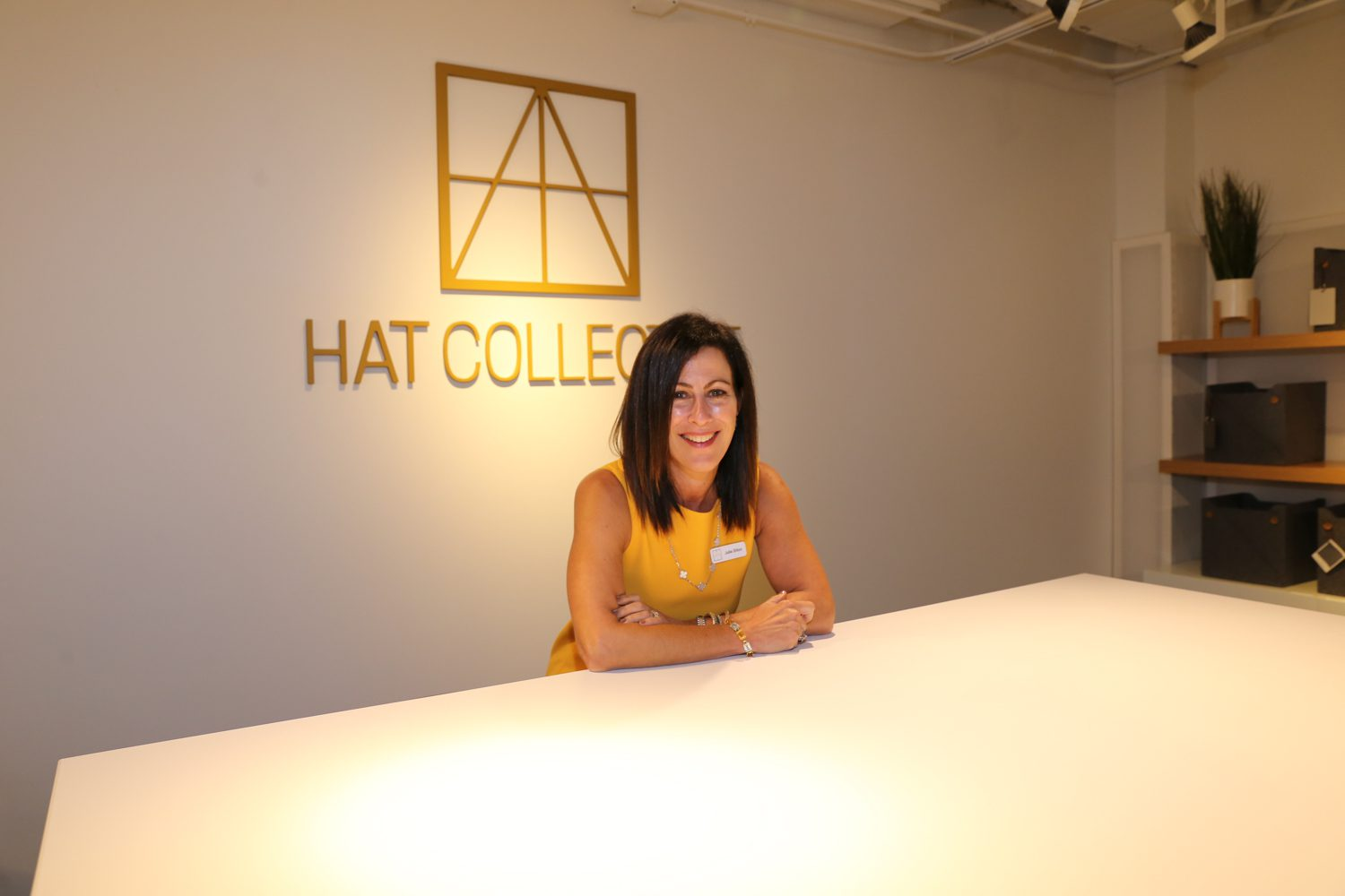Julie Dillon, sales director at HAT Collective with the Ellehaven adjustable conference table.