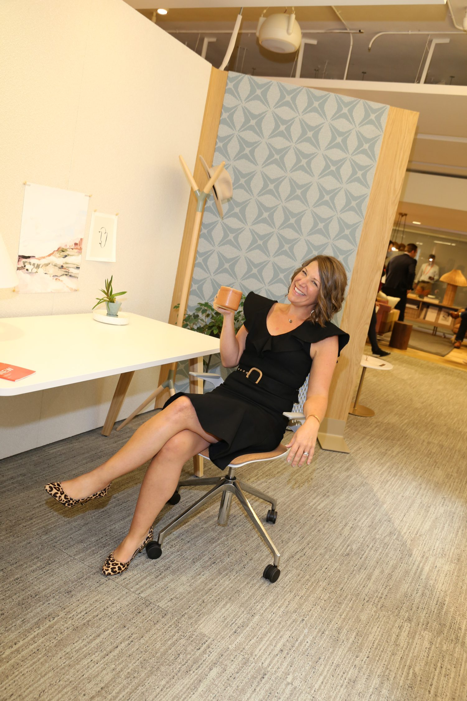 Andrea Ecret, brand manager for OFS with the Obeya architectural wall.
