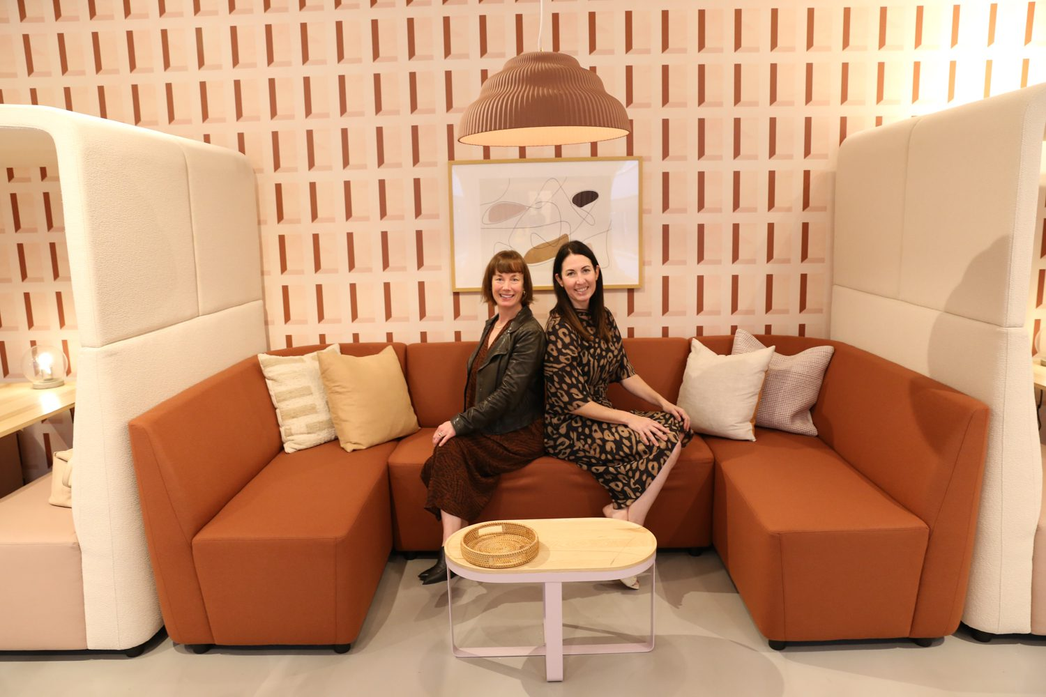 Casey Keasler, interior designer, and Jessica Ahlering, director of marketing and product management at Hightower with the FourLikes sofa.