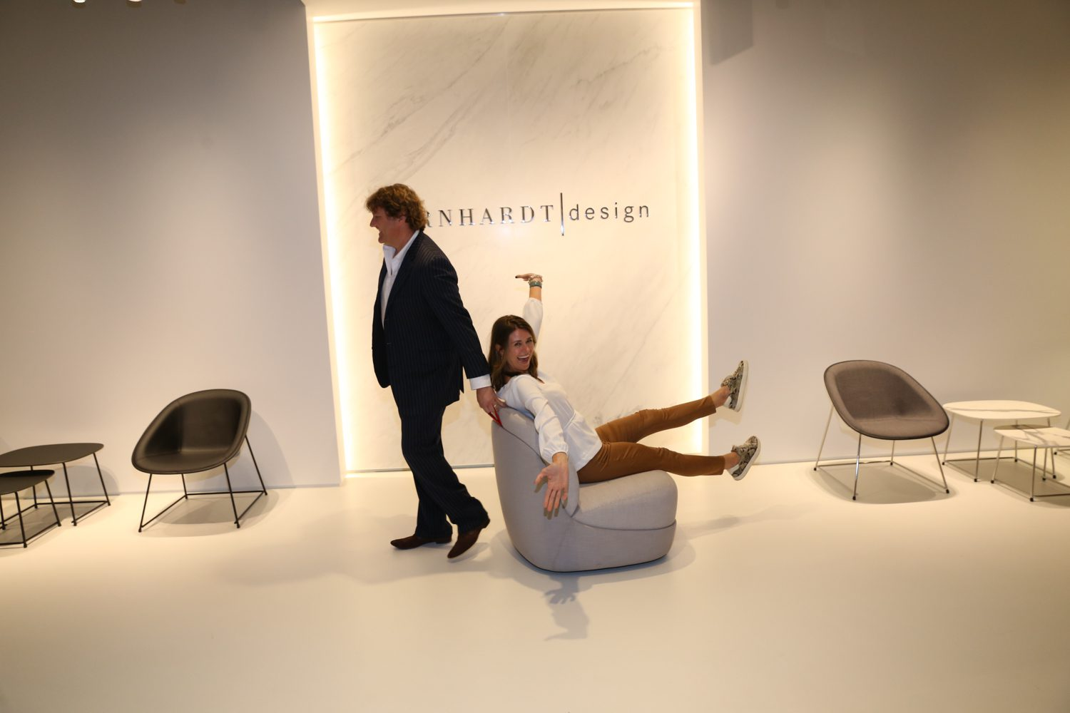 Clayton Oxford, director of marketing business production, and Tracy Bennett, sales, at Bernhardt Design with Automatic chair by Cory Grosser.