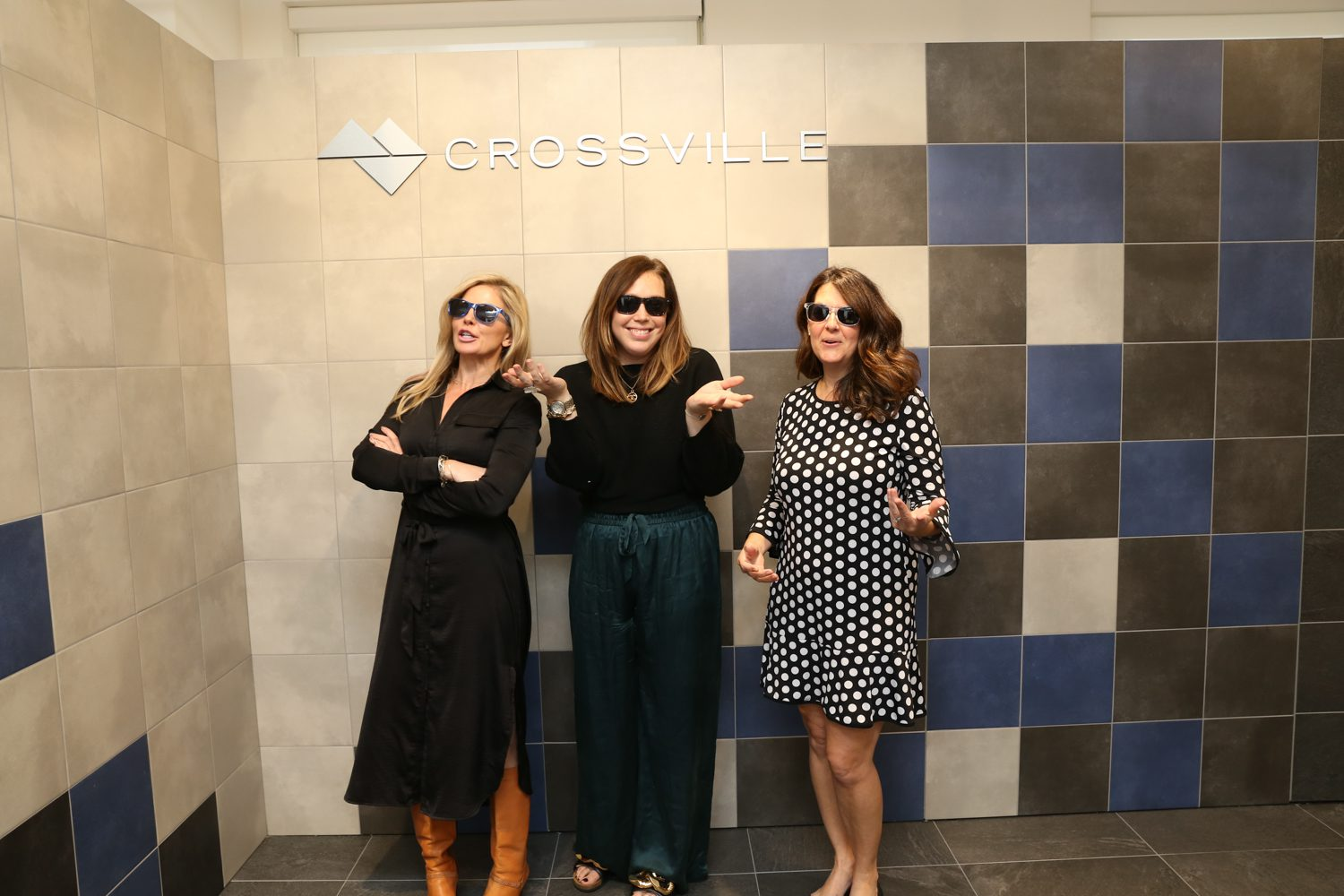 Crossville's Brooke Dominy, hospitality and management, Tori Ross, national sales, and Melanie Tatum, a&d, with the brand's Porcelain tile.