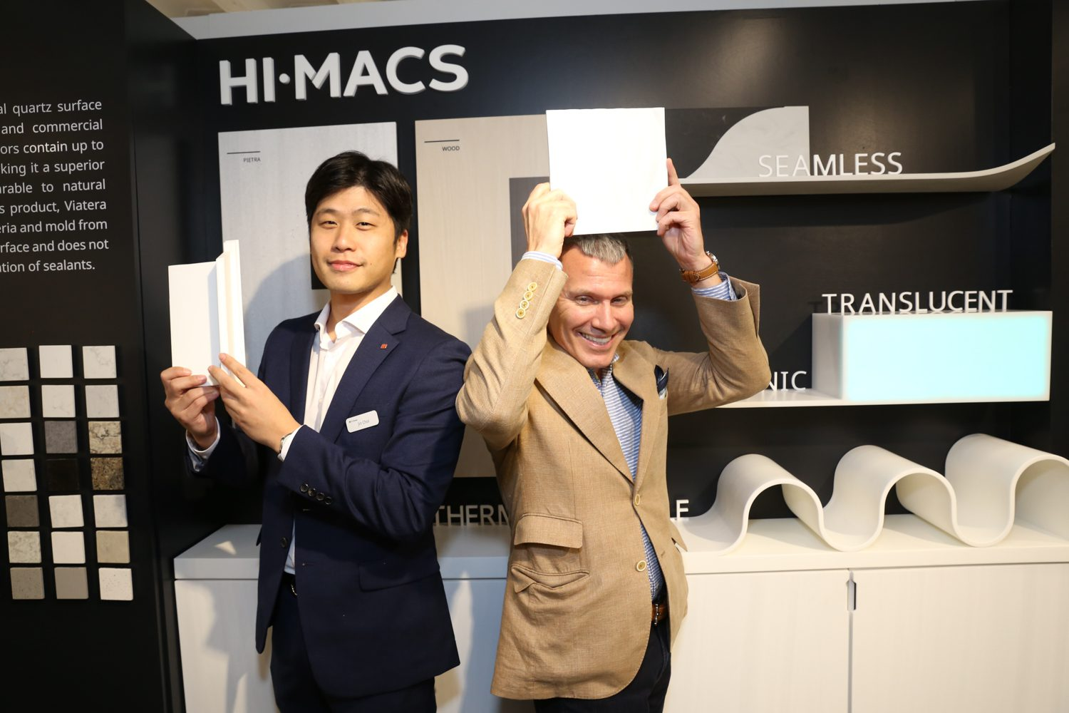 Jin Choi, product manager, and Michael Cook, sales, at LG Hausys with HI-MACS® solid surface tiles.