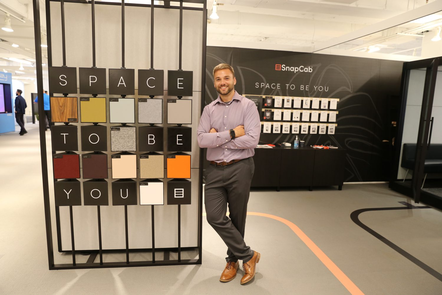 Chris Cramer, product specialist at SnapCab with the brand's privacy workspace station.