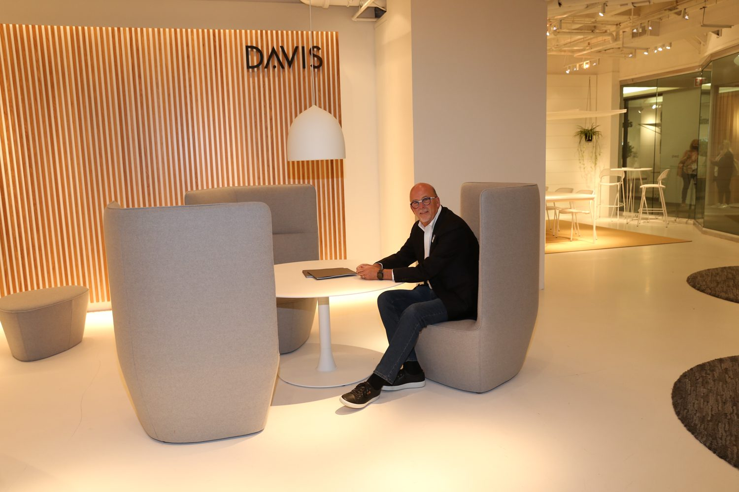 Danny Davis, president and owner of Davis Furniture with the brand's Quad lounge.