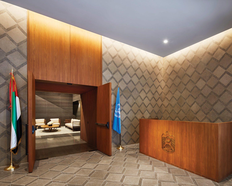 Portuguese limestone tiles clad the floor and walls of the vestibule, where custom woodwork is walnut.