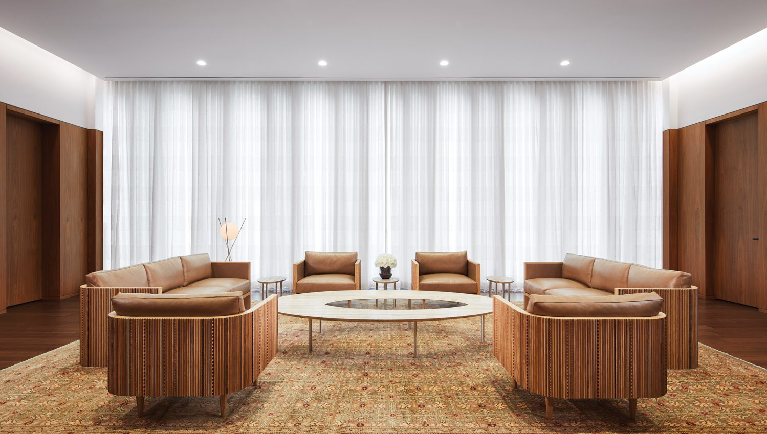Debs also designed an executive office's coffee table and marquetry-embellished sofas and armchairs.