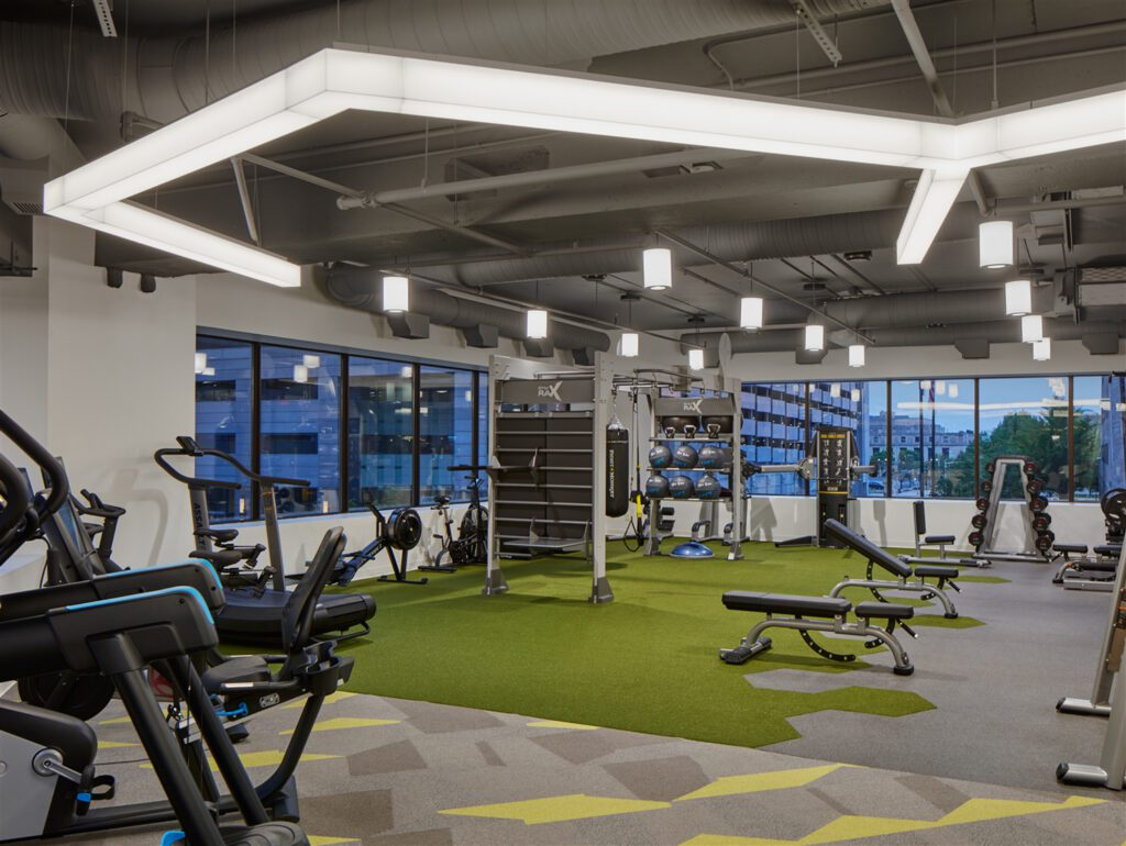 A fitness center offers users views of downtown while Shaw carpet and SPI Lighting elements sandwich the space.