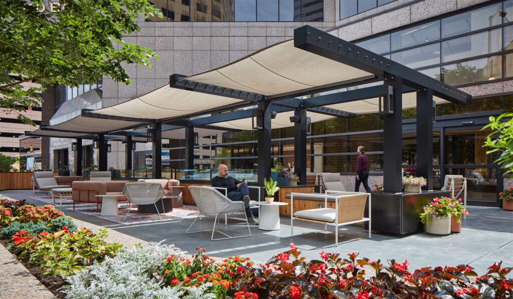 The living room-like exterior terrace lounge with Blu Dot and Andreu World furnishings offers shade via its custom aluminum canopy.