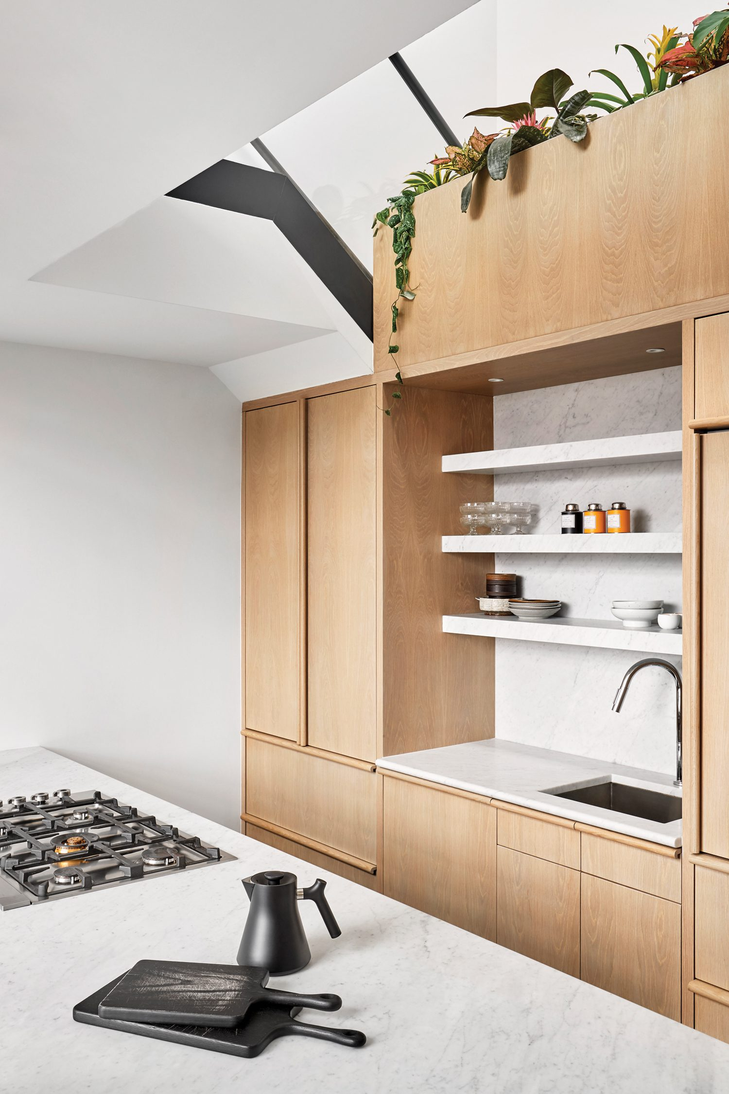 The island top, shelving, and backsplash are Cararra marble.