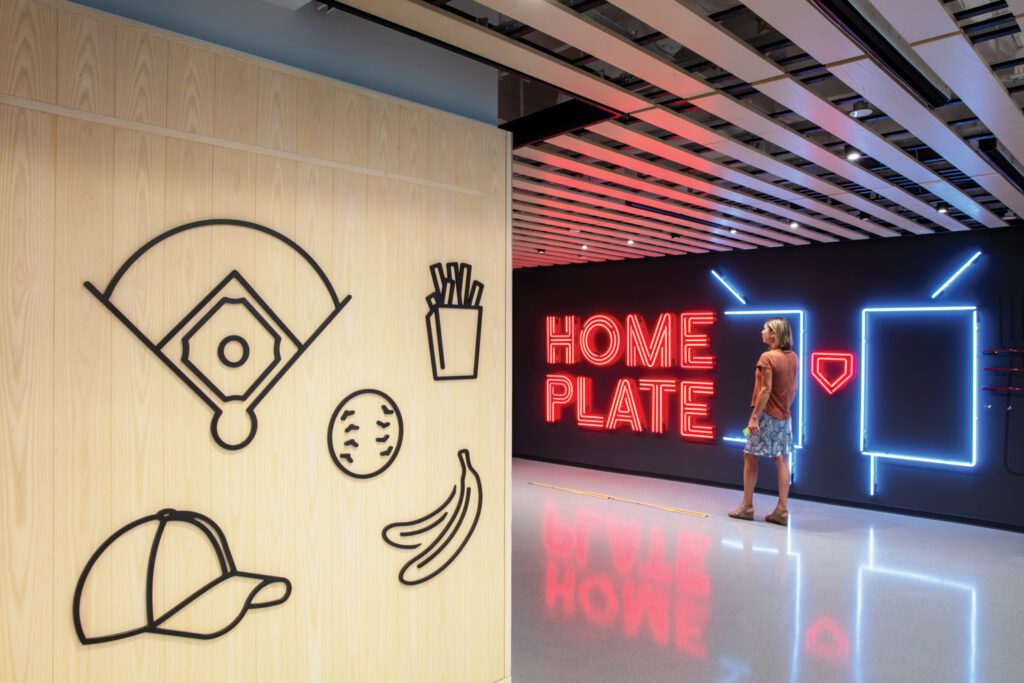 Baseball iconography—like this ash and powder-coated bronze feature wall outside the Home Plate cafeteria—drove the concept of Major League Baseball's five-story headquarters in Midtown by Studios Architecture.