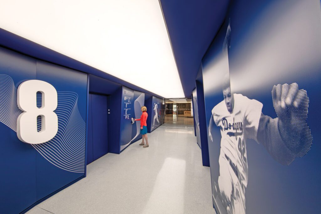 Supergraphics of players appear throughout the interior, including this powder-coated one of Jackie Robinson.