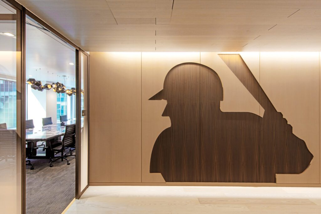 Seven types of ash, referencing the baseball bat, are used throughout, including in a wall depicting the MLB logo created by graphic designer Jerry Dior in 1968.
