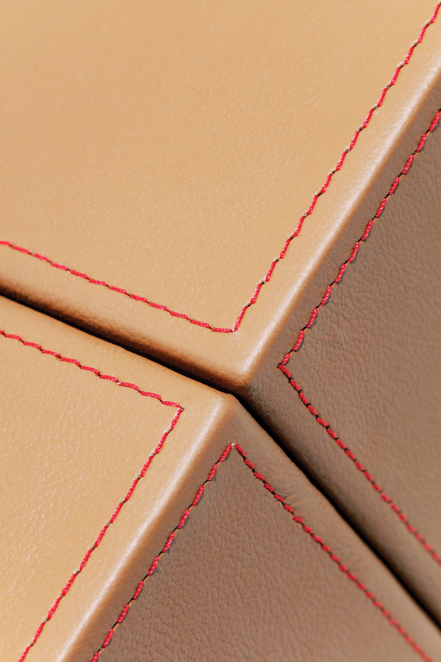 Stitching detail on the reception desk's leather top.