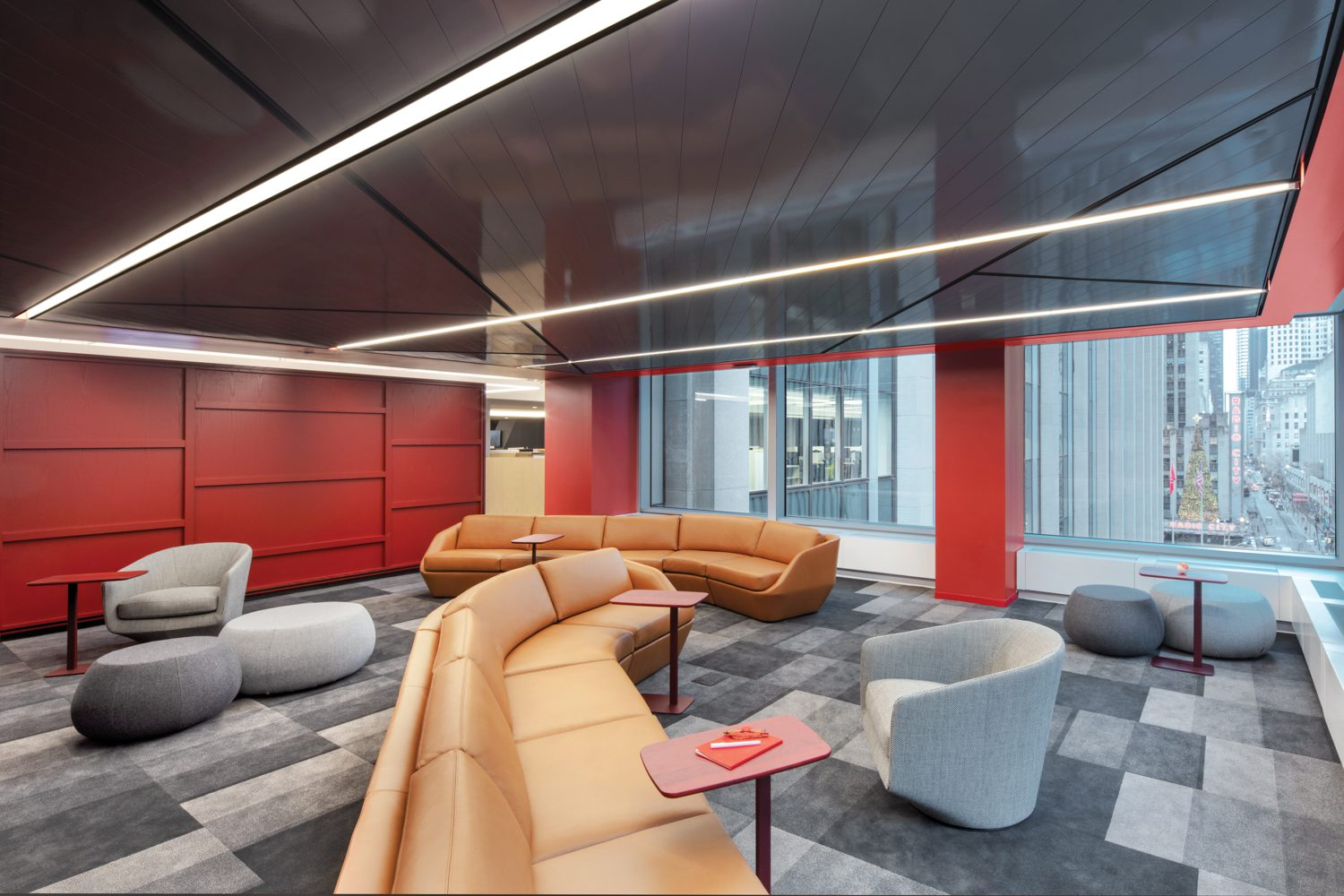 The perimeters of the four office floors host a variety of break-out areas, like this lounge furnished with Noé Duchaufour-Lawrance's Cinema sofas.