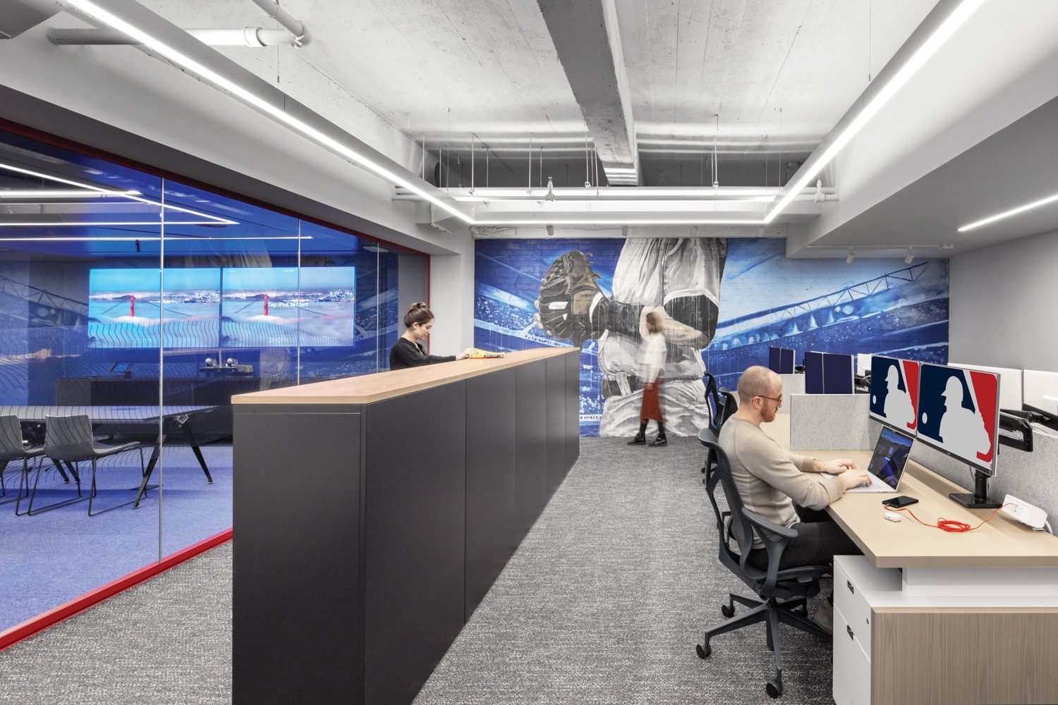 Bench seating is one of the five types of workstations in the office areas, where bays of lockers provide partitioning and employee storage.