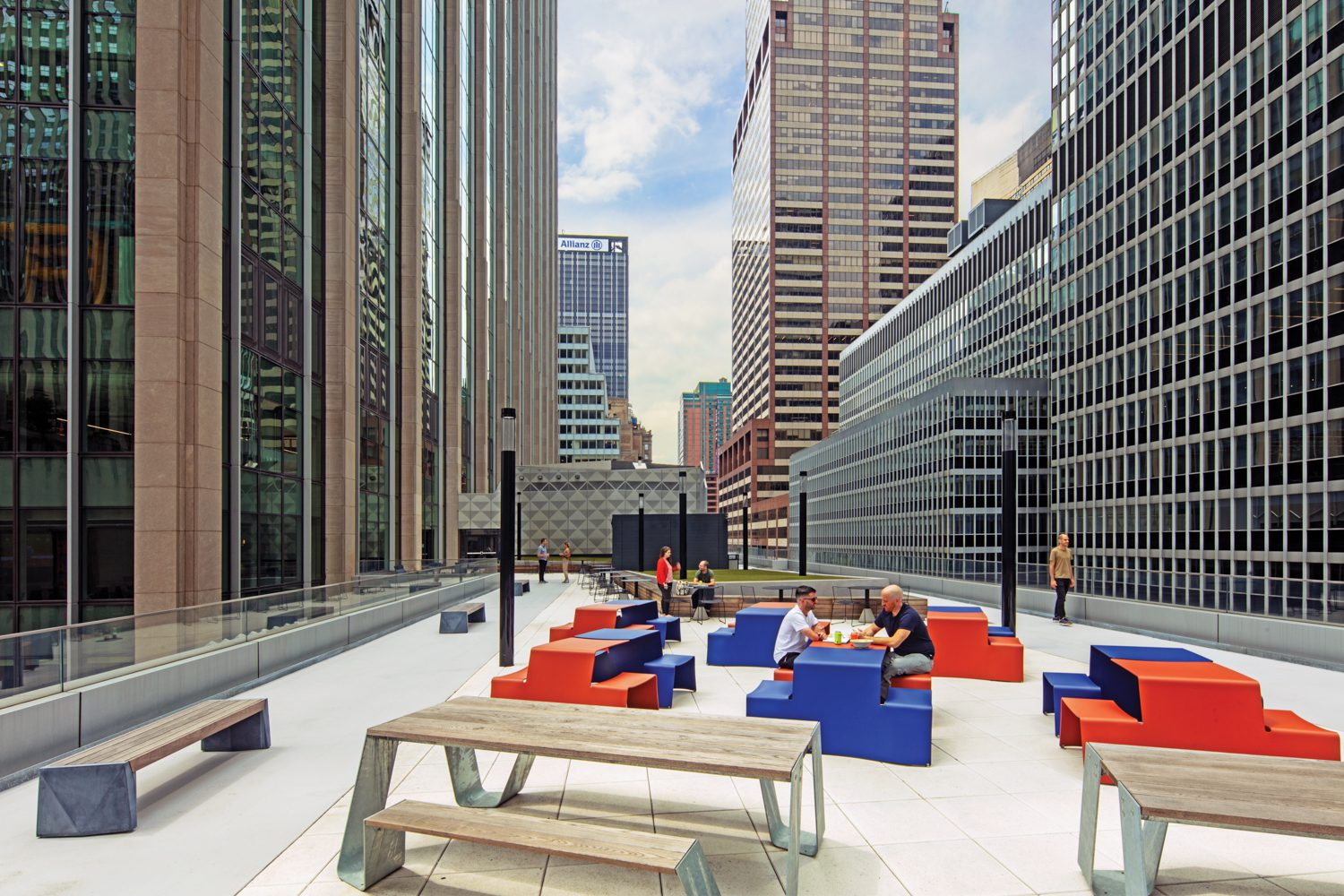 Folded aluminum Picnik tables by Extremis add color to the terrace.