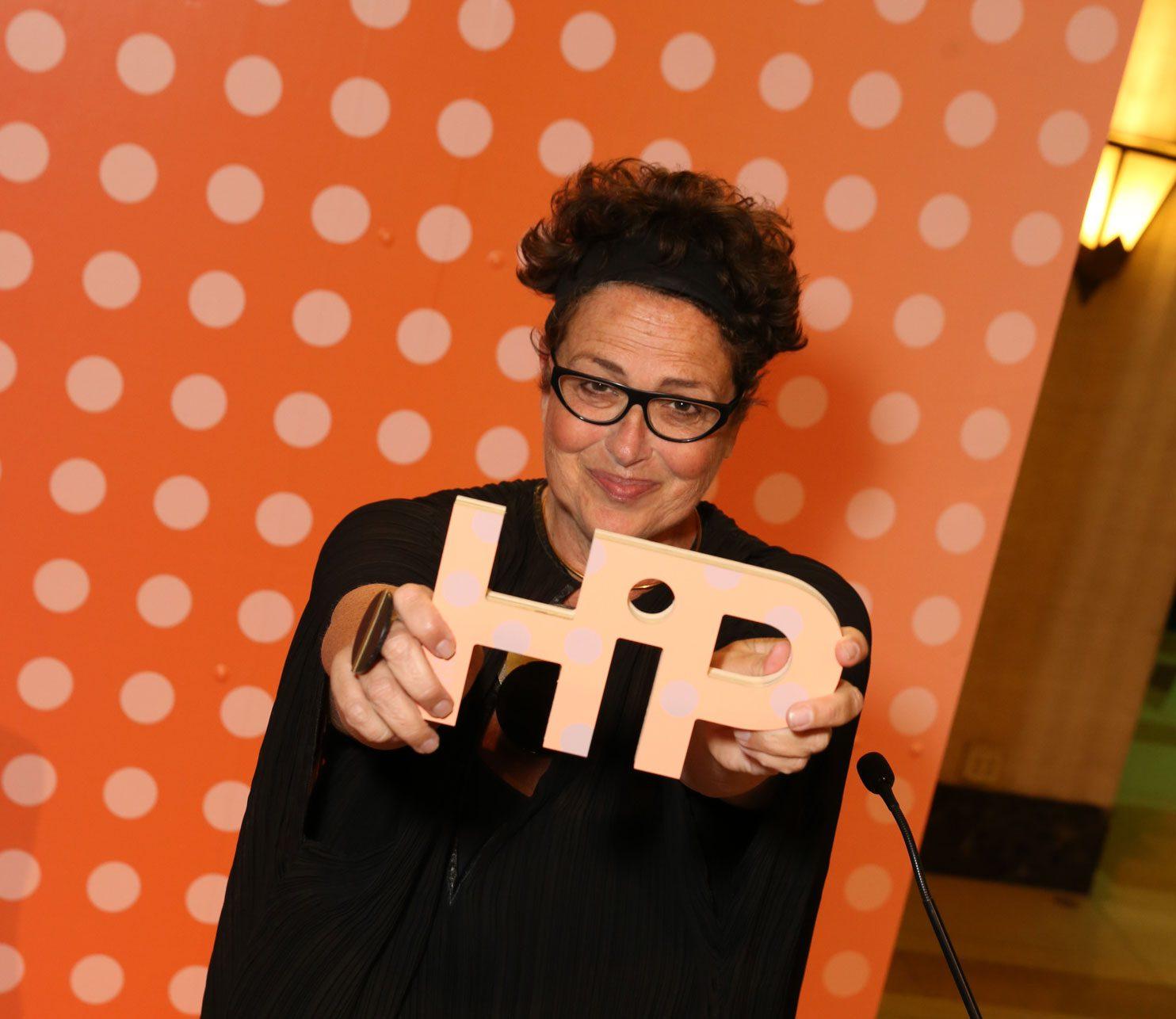 Cindy Allen holding a 2021 HiP Award.